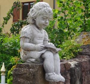 174 stone girl reading